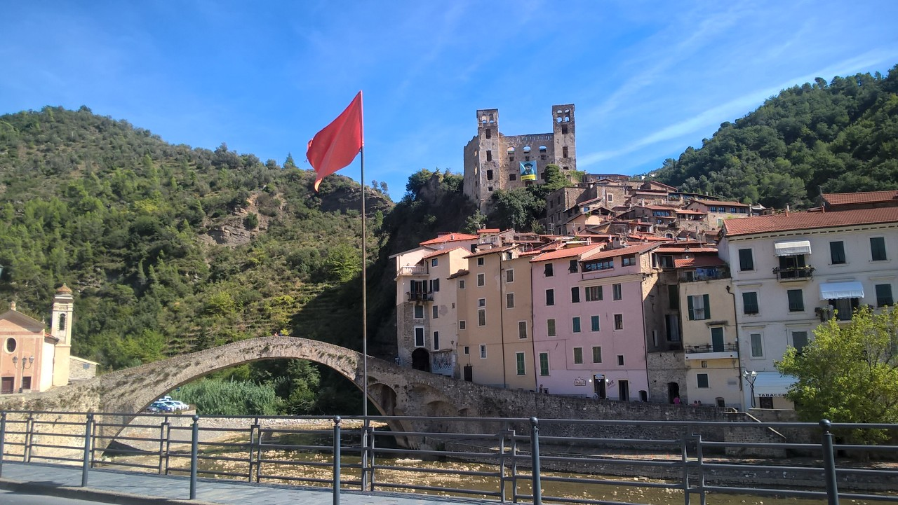 Medieval bridge over the Nervina river with old town and castle of Dolceacqua
